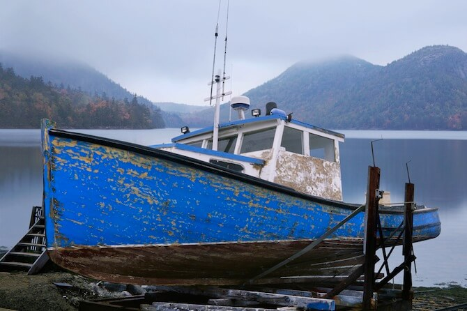 Acadia National Park, Maine, USA - An Old Lobster Boat, Beached And Waiting For A New Coat Of Paint