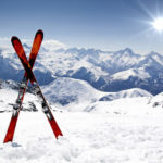 Skis crossed in the sunny snow
