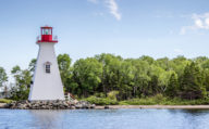 Red and White Lighthouse in Baddeck, Cape Breton in Nova Scotia