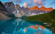 Reflecting mountains in lake Moraine in Banff National Park, BC & Alberta