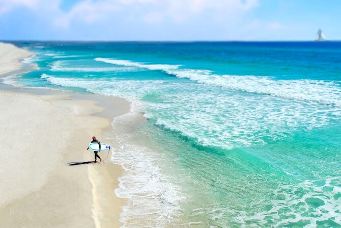 Florida Panhandle,Florida, USA - Surfer on Beach