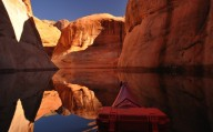Lake Powell, Utah, USA - Canoe explores the lake