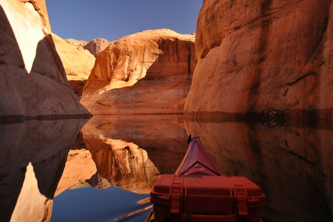 Lake Powell, Utah, USA - Canoe explores the lake