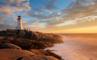 Light House on the rocks as the sun sets over Atlantic Canada