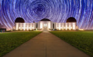 Stars pass behind the Griffith Observatory in Los Angeles