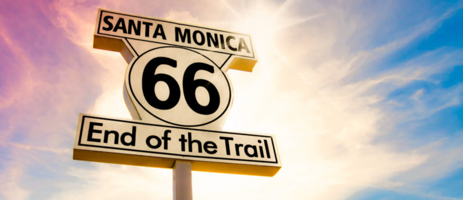 Santa Monica Route 66 End of the Trail Road Sigh against pink and blue sky
