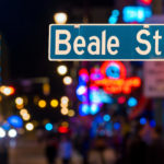 Beale Street road sign in front of neon lights