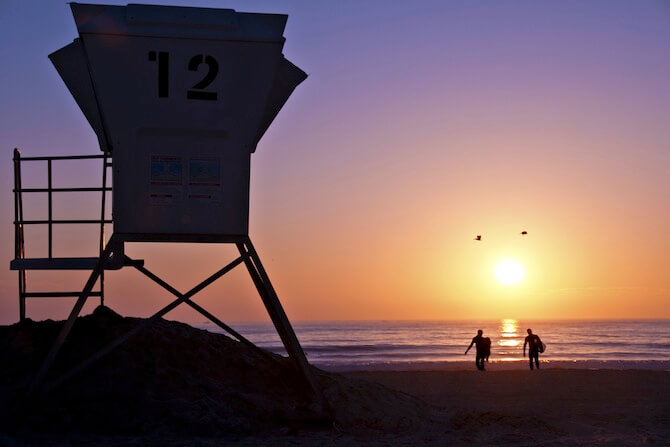San Diego, California, USA - Beach Hut with surfers
