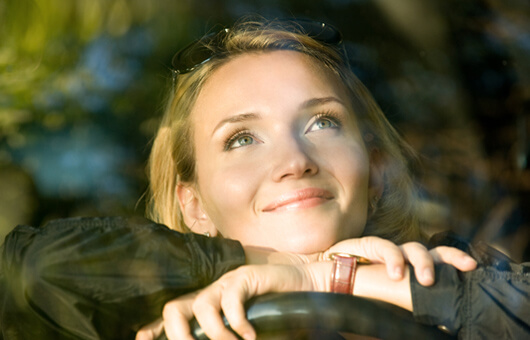 Lady in car thinking of the Best of America